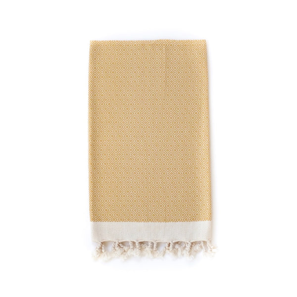 Arc Lore Samimi organic cotton hand towel in the colour mustard with woven diamond patterns.