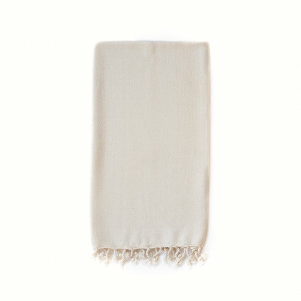 Arc Lore Samimi organic cotton hand towel in the colour oatmeal with woven diamond patterns