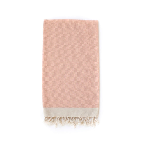 Arc Lore Samimi organic cotton hand towel in the colour apricot with woven diamond patterns.