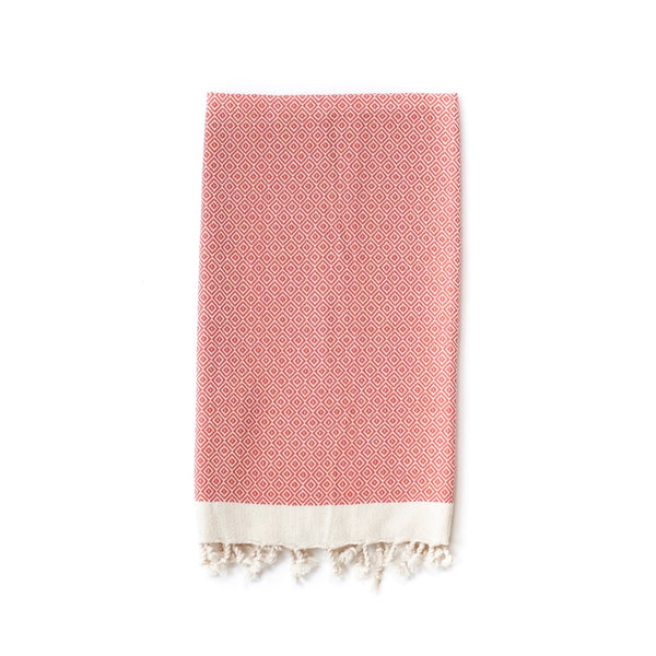 Arc Lore Samimi organic cotton hair towel in the colour burnt orange with woven diamond patterns