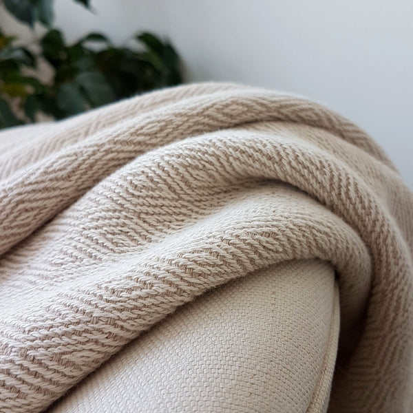 Close up of a natural coloured cotton blanket