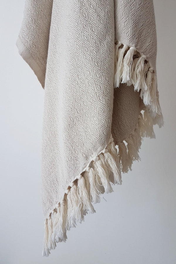 Organic cotton blanket by Arc Lore in the colour wheat hanging
