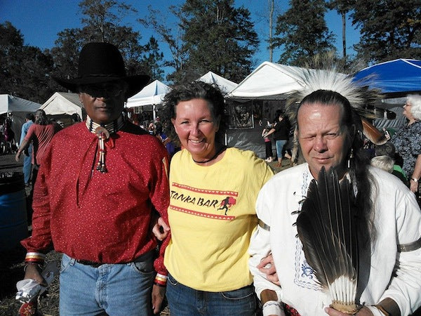 Robyn Deerchaser (center) at Waccamaw PauWau in her Tanka Bar shirt.