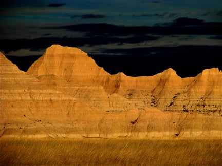 Western sun highlights a ridge in the Badlands near Pine Ridge Indian Reservation