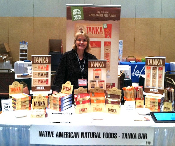 Linda Crider, director of marketing and communications, at the Tanka booth at UNFI East Spring Summer Show.