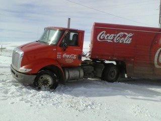 Coca-Cola truck gets stuck at Tanka headquarters