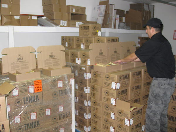 Eugene Stover, Inside Sales Manager and Customer Care, organizes boxes in the Tanka warehouse for several orders that came in a week before Christmas. Photos by Jessica Heart and Jason Stover.