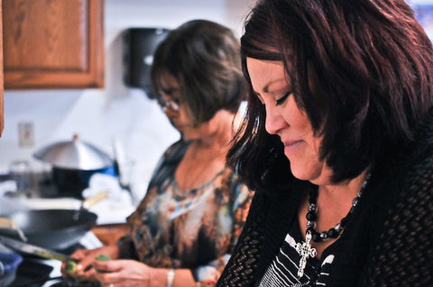 Production manager Tonya Hunter helps in the kitchen.