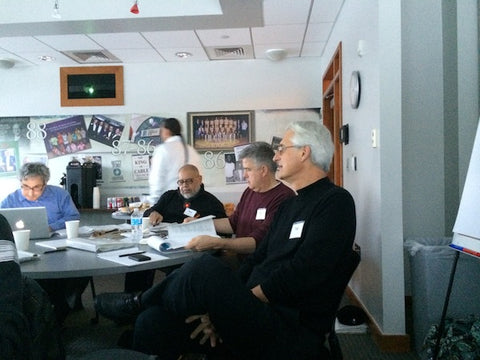 Ted, Mike and Ray of Democracy Collaborative watch the class presentations.