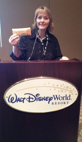 Linda Crider shows Disney a thing or two about our new flavor, Apple Orange Peel.