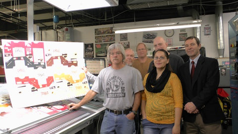 Rachel Hunter (center) with the Midlands Packaging Corporation team. Our designer Kevin Brown is pictured behind Ms. Hunter.