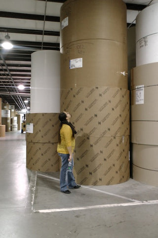 Ms. Hunter checks out the materials at Midlands Packaging Corporation.