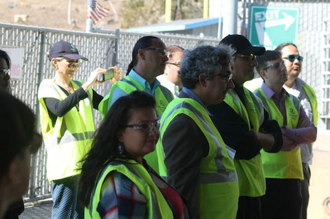 Our team learning more about an employee-owned business model, a recycling center, in Oakland. Photo courtesy of Thunder Valley CDC.