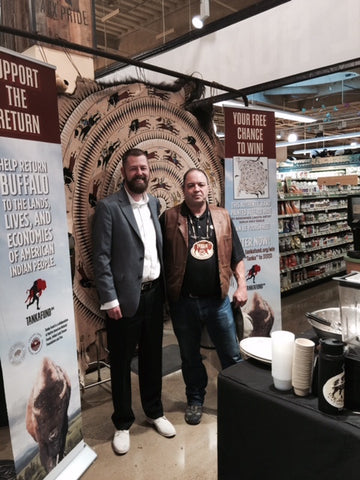 Jason Havey, Chief Operations Officer of Onnit, with Mark at the Onnit booth featuring Tanka Fund.