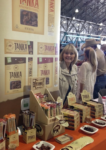 Linda Crider, director of marketing and communications, at the Tanka booth.