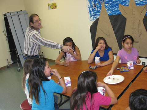 Didier DuPont with the students during their snack time.