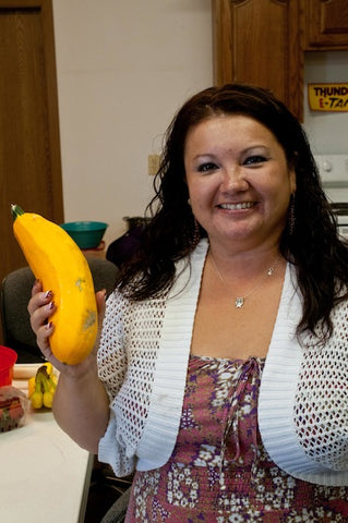 Dawn Sherman with one of her yellow squash from her garden