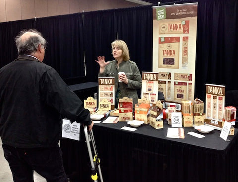 Linda chats with another vendor at the Tanka booth.