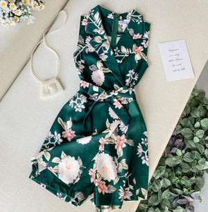 Green with flower print romper