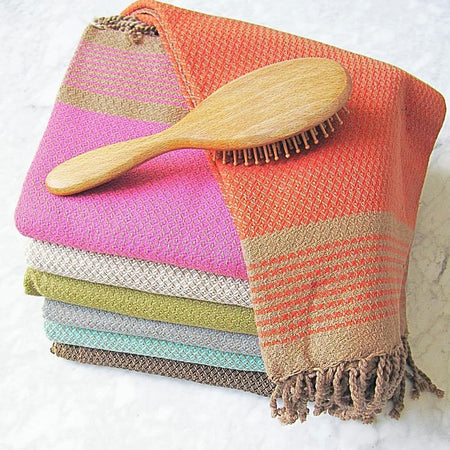 colourful pile of large cotton hammam towel with honeycomb pattern and hand finished tassels