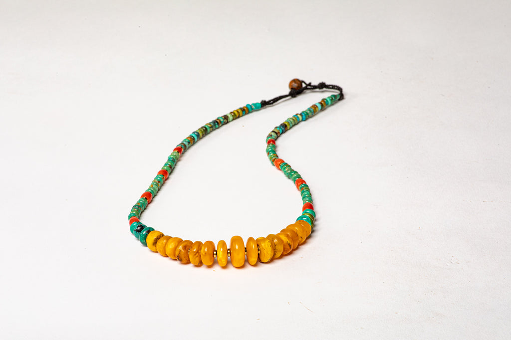 Turquoise necklace with antique milky Amber center