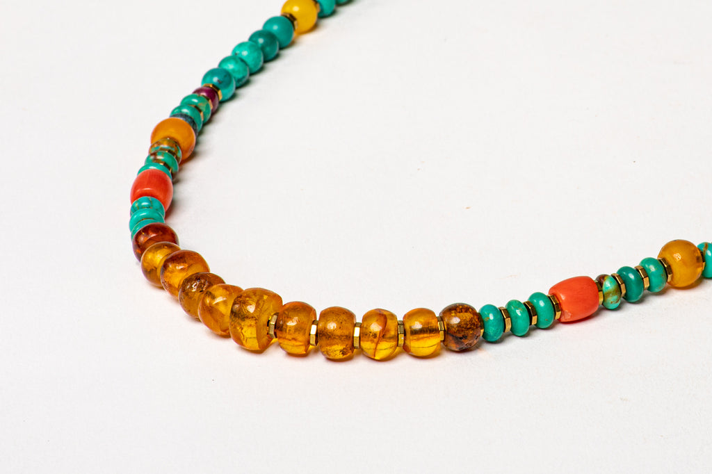 Turquoise necklace with Amber center