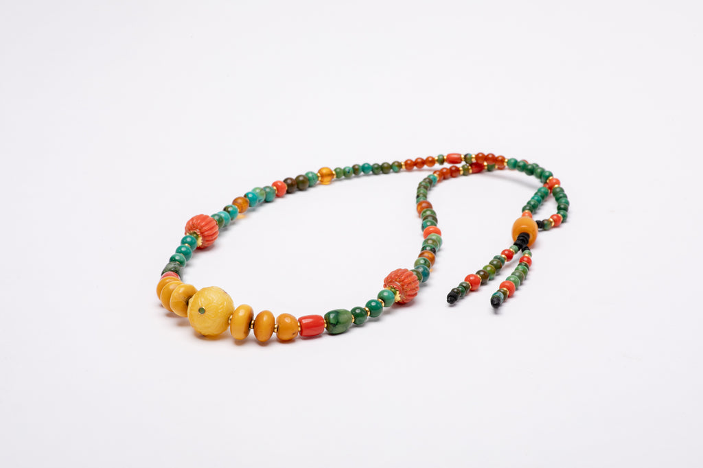 flower carved amber stone with gold beads mala necklace