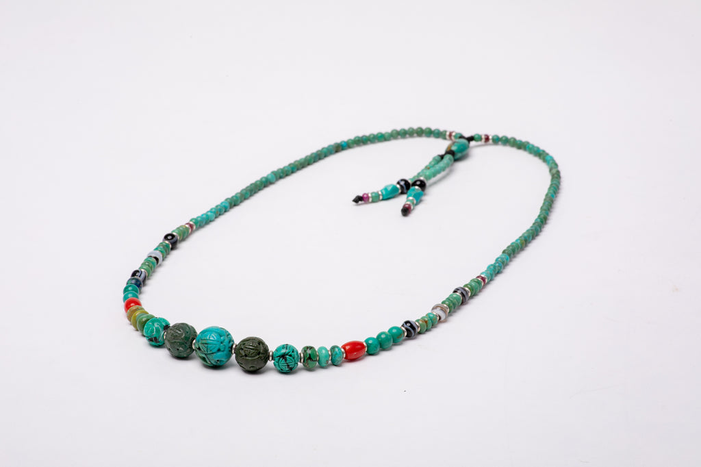 Carved turquoise tassel mala necklace