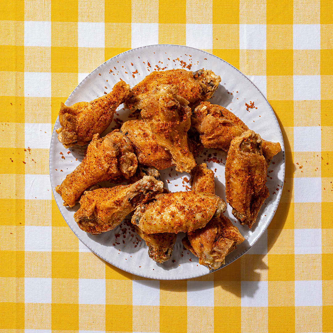 A plate of Cajun Lime Wings - a zesty dry rub made with brown sugar, salt, pepper, lime and chili peppers, that makes for a real finger-licking treat. Available boneless or bone in.