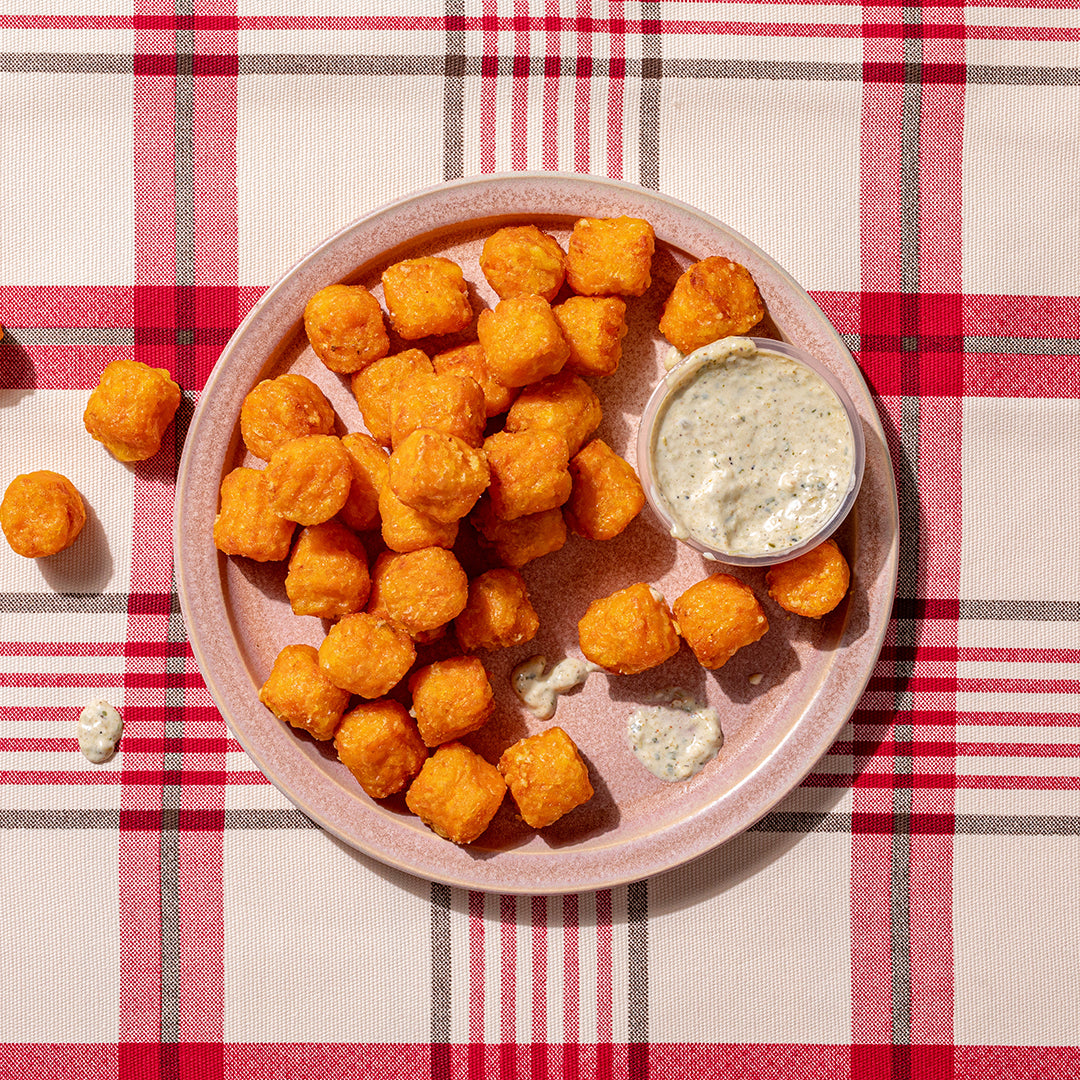 A side of Sweet Potato Tots - with jalapeño aioli on the side.