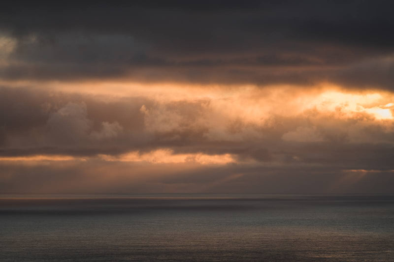 Clouds in Orange Colors over the Faroe Islands