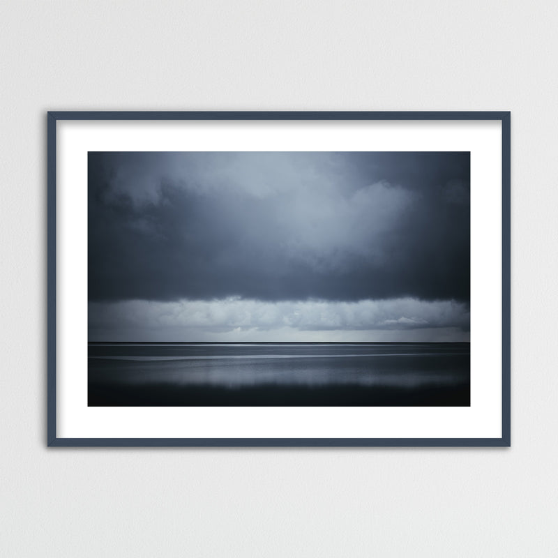 Dark Clouds over the Ocean | Framed Photo Print by Jan Erik Waider