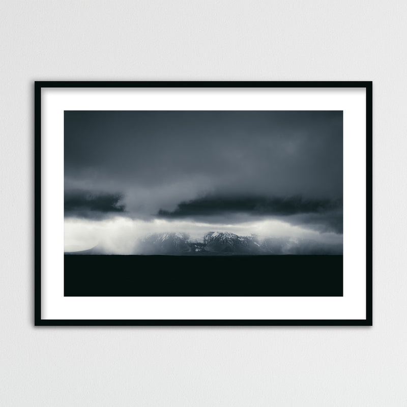 Dark and Monochrome Clouds over Iceland | Framed Photo Print by Jan Erik Waider