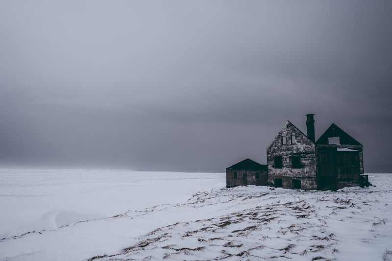 Abandoned House in Snowy Landscape of Iceland