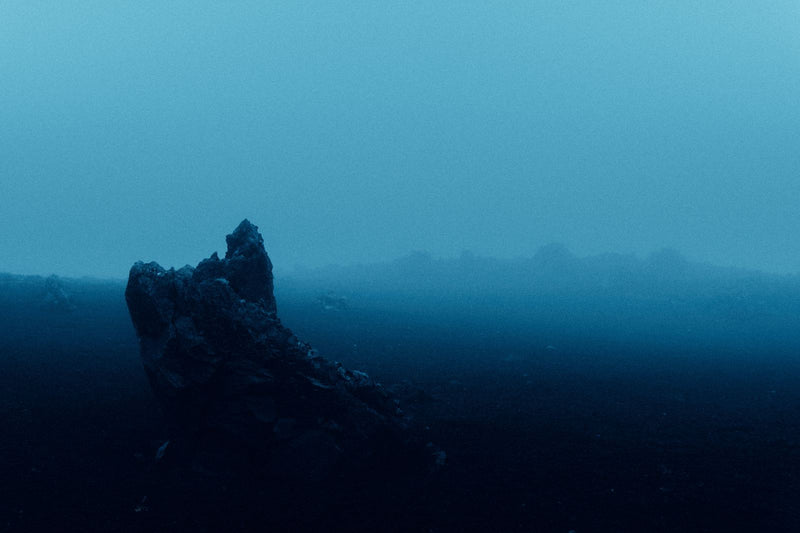 Surreal Blue Light over Desert Landscape in Iceland