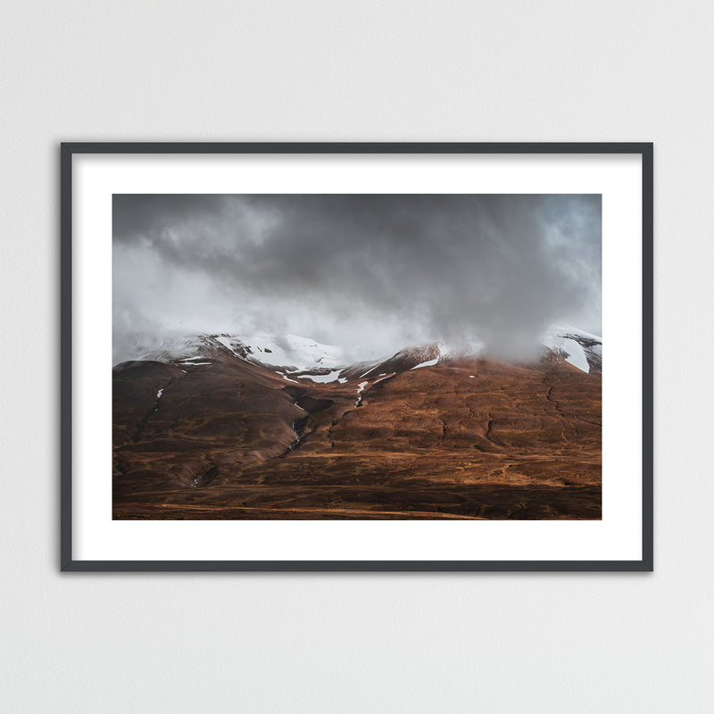 Clouds Retreating into the Mountains of Iceland | Framed Photo Print by Jan Erik Waider