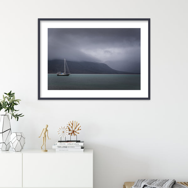 Small Sailboat and Dark Clouds | Wall Art Print by Jan Erik Waider