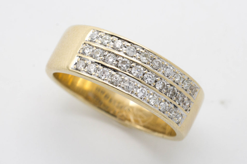 18 carat gold band with diamond rows.