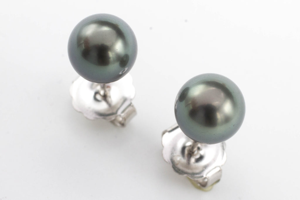 Mikimoto black Tahitian south sea pearl earrings in white gold.