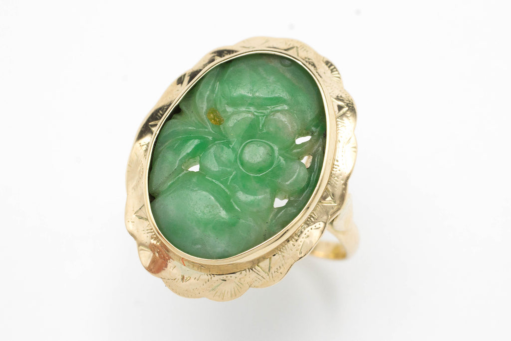 Carved jade ring in 14 carat gold.