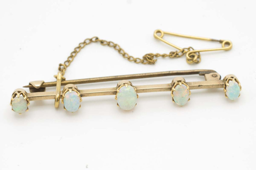 Antique gold bar brooch with five opal stones