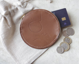 Round Leather Embossed Coin Purse In Tan