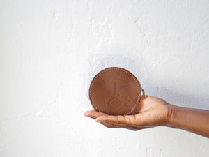 Round leather coin in beige face embossing