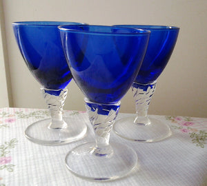 Three Cobalt Blue Glass Cordial Glasses with Twisted Clear Stems