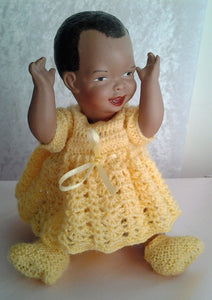 Vintage Black Porcelain Mandy Doll with Handknitted Yellow Dress