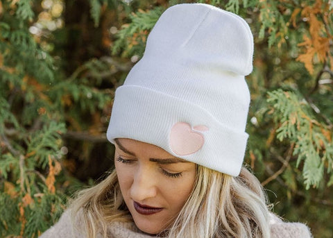 Give the gift of coziness this winter with our white fitted toque, accented by peachy embroidered logo. Exclusive Girl Gang Canada merchandise!