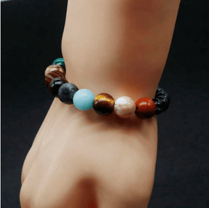 Beautiful universe bracelet wearing in hand