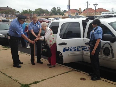 Edie Simms getting out of police car