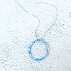 light blue fine silver enamel open circle karma necklace with sterling silver chain