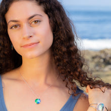 Load image into Gallery viewer, model at beach with ocean colors silver enamel necklace seaside harmony